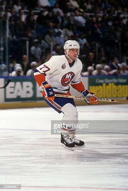 Pierre Turgeon of the New York Islanders skates on the ice during an NHL game in March 1993 at the Nassau Coliseum in Uniondale New York