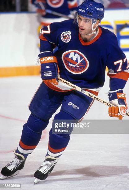 Pierre Turgeon of the New York Islanders skates on the ice during an NHL preseason game in September 1992
