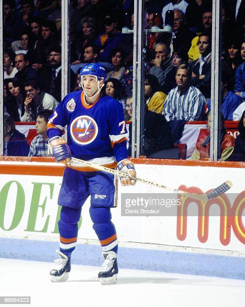 Pierre Turgeon of the New York Islanders skates on the ice during an NHL game against the Montreal Canadiens circa 1993 at the Montreal Forum in...