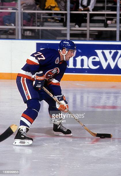 Pierre Turgeon of the New York Islanders skates with the puck during an NHL game against the New York Rangers on October 18, 1992 at the Madison...