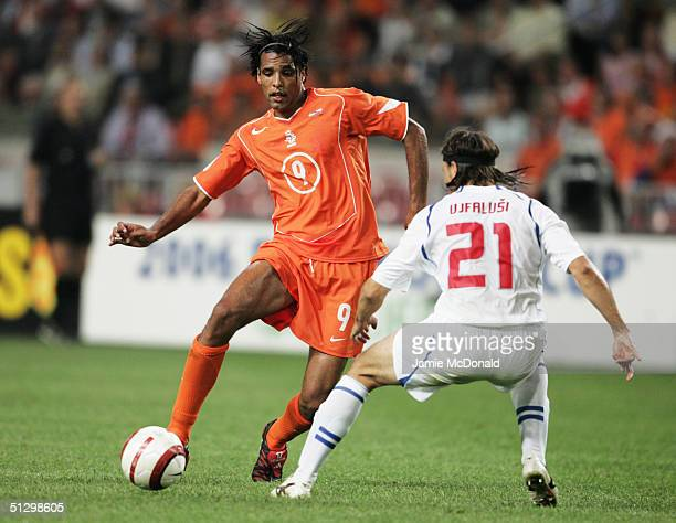 Pierre van Hooijdonk of Holland takes on Tomas Ujfalusi of Czech Republic during the World Cup qualification Group 1 match between Holland v Czech...