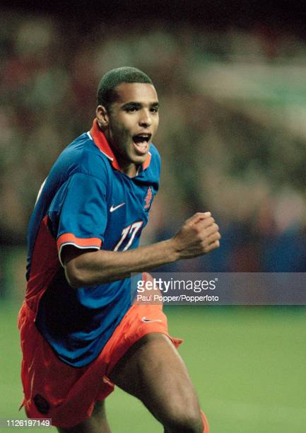 Pierre Van Hooijdonk of the Netherlands celebrates after scoring during the 1998 FIFA World Cup Qualifying match between Wales and the Netherlands at...