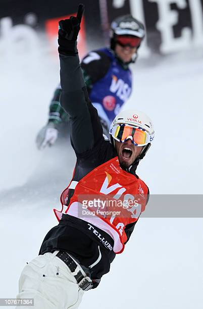 Pierre Vaultier of France celebrates his victory over Seth Wescott of the USA in second place in the finals of the Men's Snowboard Cross at the LG...