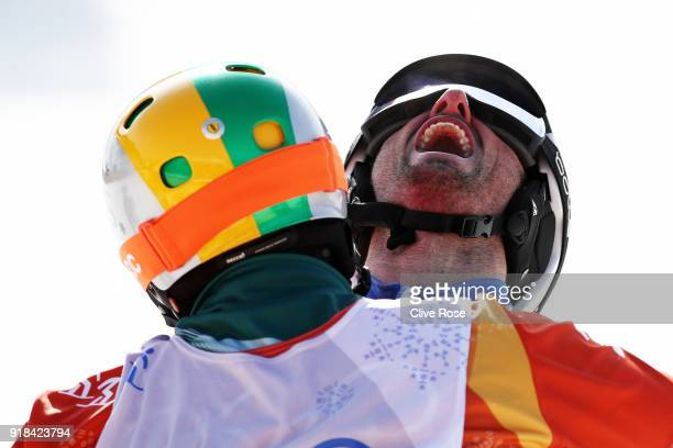 Pierre Vaultier of France celebrates winning gold with silver medalist Jarryd Hughes of Australia in the Men's Snowboard Cross Big Final on day six...