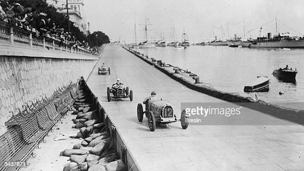Pierre Veyron drives the Type 51 Bugatti ahead of Carlo Felice Trossi driving the Scuderia Ferrari P3 Type B Alfa Romeo during the Grand Prix of...
