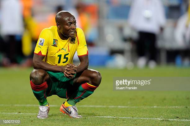 Pierre Webo of Cameroon is dejected after defeat in the 2010 FIFA World Cup South Africa Group E match between Japan and Cameroon at the Free State...