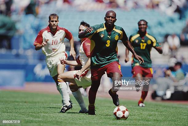 Pierre Wome of Cameroon makes a run with the ball during play in the final of the Men's football tournament at the 2000 Summer Olympics in the...