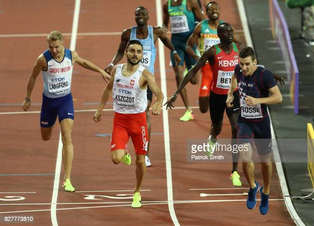 Pierre-Ambroise Bosse of France crosses the finish line to win the Men's 800 metres final ahead of Adam Kszczot of Poland, Kipyegon Bett of Kenya and...