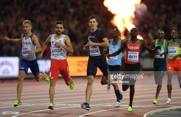 PierreAmbroise Bosse of France crosses the finish line to win the Men's 800 metres final ahead of Adam Kszczot of Poland Kipyegon Bett of Kenya and...