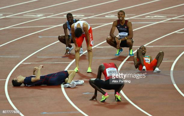 PierreAmbroise Bosse of France gold and Adam Kszczot of Poland silver react after the Men's 800 metres final during day five of the 16th IAAF World...
