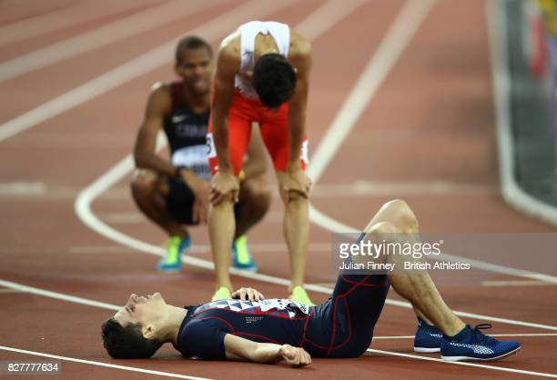 Pierre-Ambroise Bosse of France, gold, and Adam Kszczot of Poland, silver, react after the Men's 800 metres final during day five of the 16th IAAF...