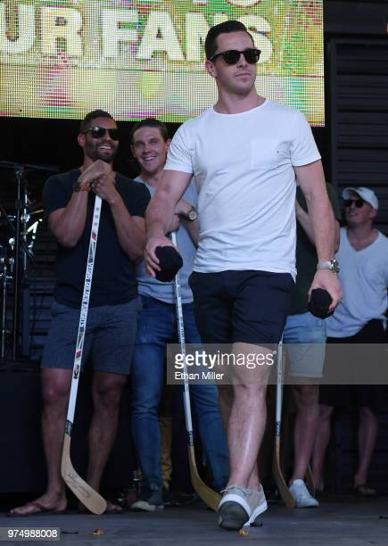 PierreEdouard Bellemare and Erik Haula of the Vegas Golden Knights look on as teammate Jonathan Marchessault is introduced at the team's 'Stick...