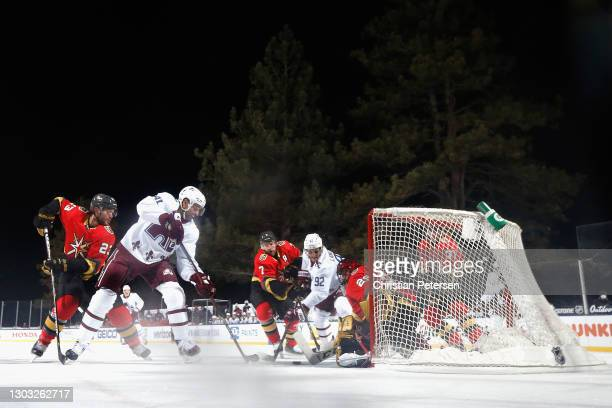 Pierre-Edouard Bellemare and Gabriel Landeskog of the Colorado Avalanche are stopped by Marc-Andre Fleury of the Vegas Golden Knights during the...
