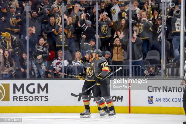 PierreEdouard Bellemare and Ryan Reaves of the Vegas Golden Knights celebrate a first period goal against the Winnipeg Jets at TMobile Arena on...