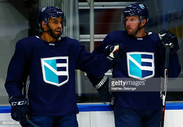 Pierre-Edouard Bellemare and Thomas Vanek of Team Europe speak together during a practice at the Centre Videotron on September 7, 2016 in Quebec...