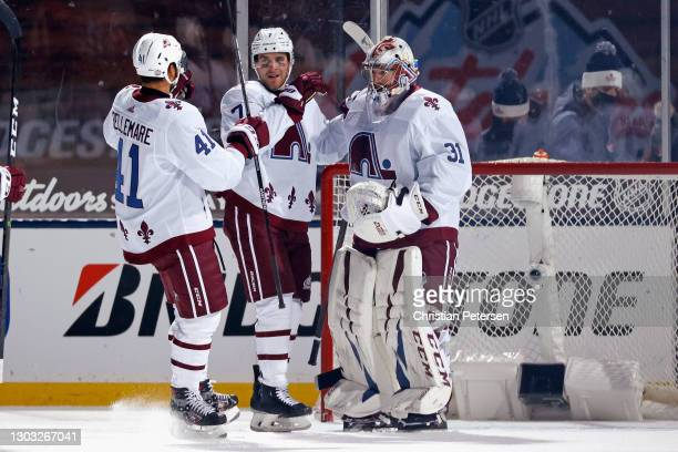 Pierre-Edouard Bellemare, Devon Toews and Philipp Grubauer of the Colorado Avalanche celebrate their 3-2 victory over the Vegas Golden Knights during...
