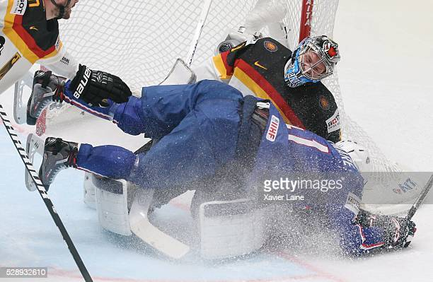 PierreEdouard Bellemare of France jump over Timo Pielmeier of Germany during the 2016 IIHF World Championship between France and Germany at Yubileyny...