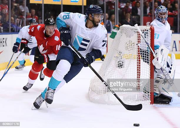 PierreEdouard Bellemare of Team Europe stickhandles the puck with Jonathan Toews of Team Canada chasing during the World Cup of Hockey 2016 at Air...