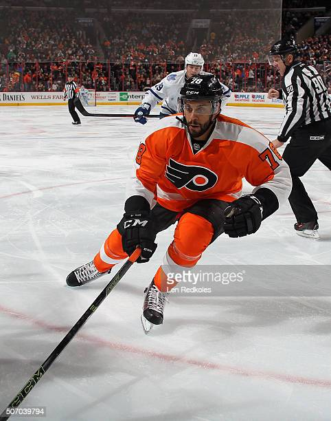PierreEdouard Bellemare of the Philadelphia Flyers skates in the corner against Joffery Lupul of the Toronto Maple Leafs on January 19 2016 at the...