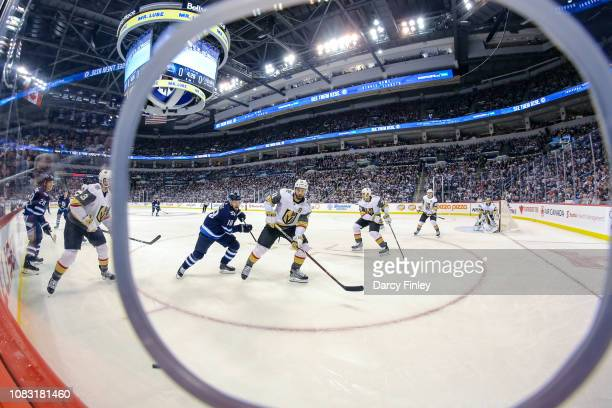 PierreEdouard Bellemare of the Vegas Golden Knights and Bryan Little of the Winnipeg Jets keep an eye on the play during first period action at the...