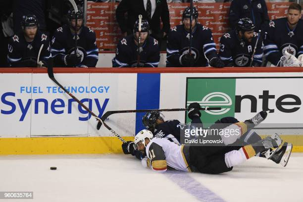 PierreEdouard Bellemare of the Vegas Golden Knights and Patrik Laine of the Winnipeg Jets fall on the ice during the third period in Game Five of the...
