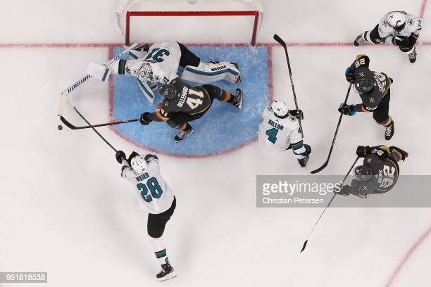 PierreEdouard Bellemare of the Vegas Golden Knights attempts to play the puck ahead of Timo Meier and goaltender Martin Jones of the San Jose Sharks...