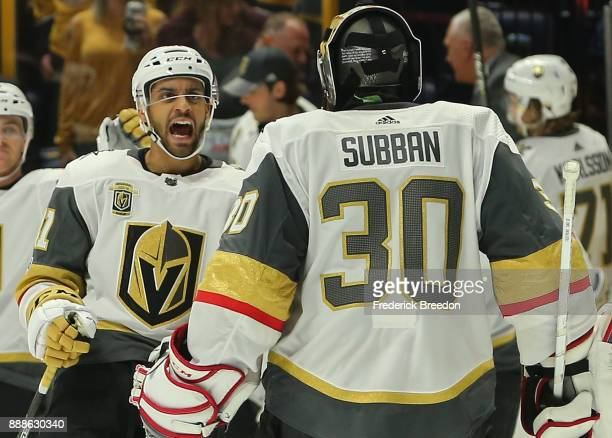 PierreEdouard Bellemare of the Las Vegas Golden Knights congratulates teammate Malcolm Subban on a victory over of the Nashville Predators in a...