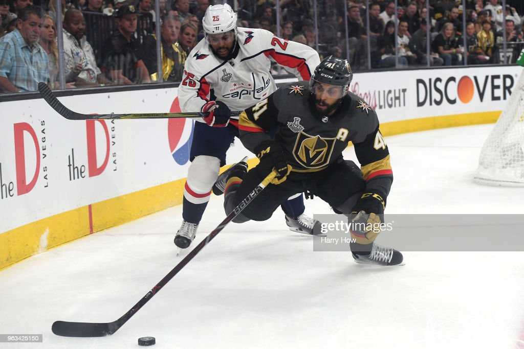 Pierre-Edouard Bellemare #41 of the Vegas Golden Knights is defended by Devante Smith-Pelly #25 of the Washington Capitals during the second period in Game One of the 2018 NHL Stanley Cup Final at T-Mobile Arena on May 28, 2018 in Las Vegas, Nevada.