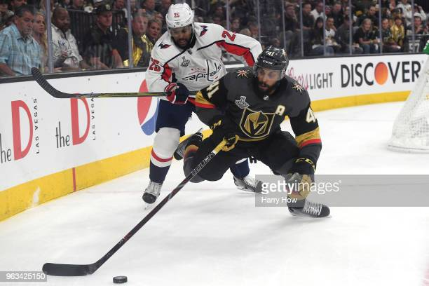 PierreEdouard Bellemare of the Vegas Golden Knights is defended by Devante SmithPelly of the Washington Capitals during the second period in Game One...