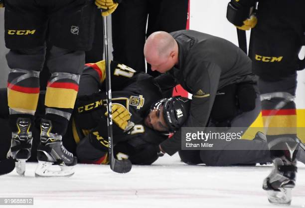 PierreEdouard Bellemare of the Vegas Golden Knights is tended to after he and Victor Mete of the Montreal Canadiens crashed into the boards in the...