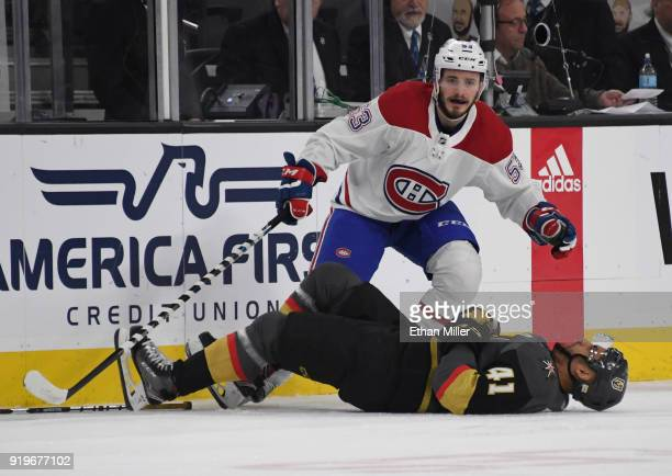 PierreEdouard Bellemare of the Vegas Golden Knights lies on the ice after he and Victor Mete of the Montreal Canadiens crashed into the boards in the...