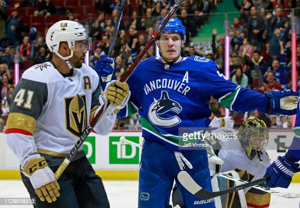 PierreEdouard Bellemare of the Vegas Golden Knights looks on dejected as Bo Horvat of the Vancouver Canucks celebrates after scoring during their NHL...