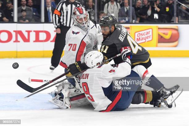 PierreEdouard Bellemare of the Vegas Golden Knights takes a shot on Braden Holtby as Dmitry Orlov of the Washington Capitals defends during the first...