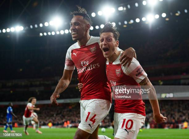 PierreEmerick Aubamayang of Arsenal celebrates with Mesut Ozil after scoring Arsenal's third goal during the Premier League match between Arsenal FC...