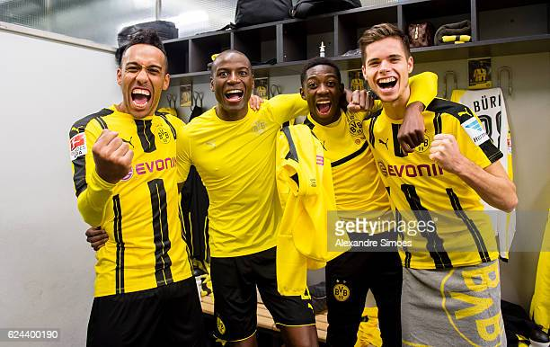 PierreEmerick Aubameyang Adrian Ramos Ousmane Dembele and Julian Weigl of Borussia Dortmund celebrates the win after the final whistle during the...