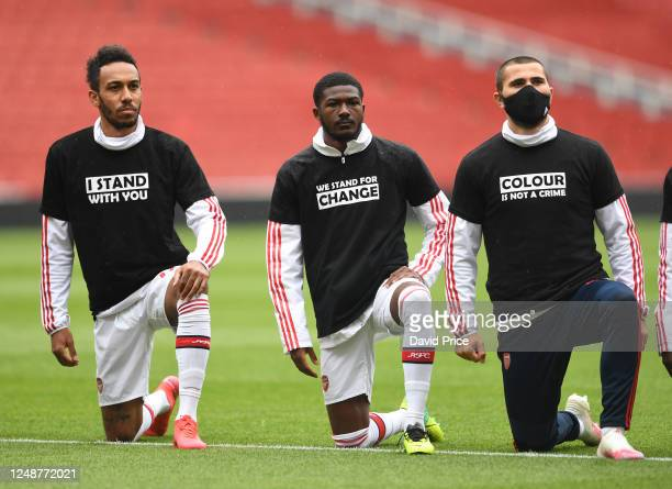 PierreEmerick Aubameyang Ainsley MaitlandNiles and Sead Kolasinac of Arsenal take a knee in support of Black Lives Matter before the friendly match...