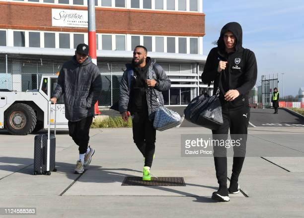 PierreEmerick Aubameyang Alexandre Lacazette and Matteo Guendouzi of Arsenal board the plane at Luton Airport on February 13 2019 in Luton England
