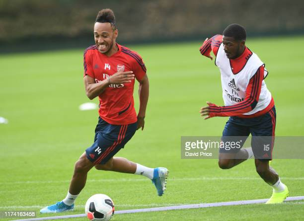 Pierre-Emerick Aubameyang and Ainsley Maitland-Niles of Arsenal during the Arsenal Training Session at London Colney on September 12, 2019 in St...