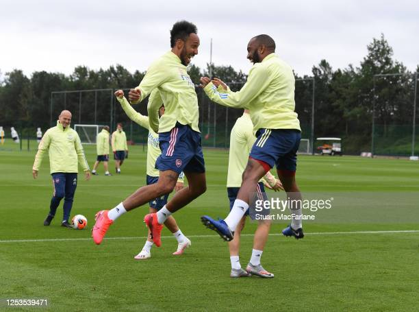 Pierre-Emerick Aubameyang and Alex Lacazette of Arsenal during a training session at London Colney on June 30, 2020 in St Albans, England.