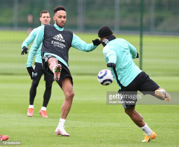 Pierre-Emerick Aubameyang and Alex Lacazette of Arsenal during a training session at London Colney on May 22, 2021 in St Albans, England.