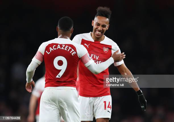 PierreEmerick Aubameyang and Alexandre Lacazette of Arsenal celebrate victory after the the Premier League match between Arsenal FC and Newcastle...