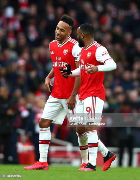 PierreEmerick Aubameyang and Alexandre Lacazette of Arsenal celebrate after the Premier League match between Arsenal FC and West Ham United at...