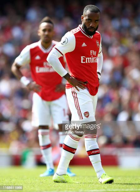PierreEmerick Aubameyang and Alexandre Lacazette of Arsenal look on during the Premier League match between Arsenal FC and Burnley FC at Emirates...