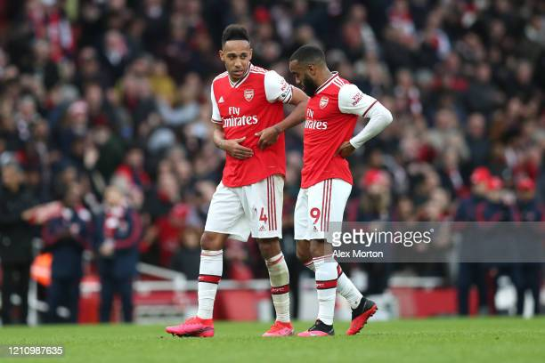 PierreEmerick Aubameyang and Alexandre Lacazette of Arsenal talk following their sides victory in the Premier League match between Arsenal FC and...