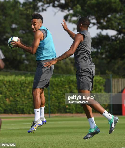 PierreEmerick Aubameyang and Chuba Akpom of Arsenal share a joke during a training session at London Colney on July 9 2018 in St Albans England