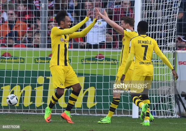 PierreEmerick Aubameyang and Erik Durm of Borussia Dortmund celebrates 2nd goal od Aubameyang during the Bundesliga match between Sport Club Freiburg...