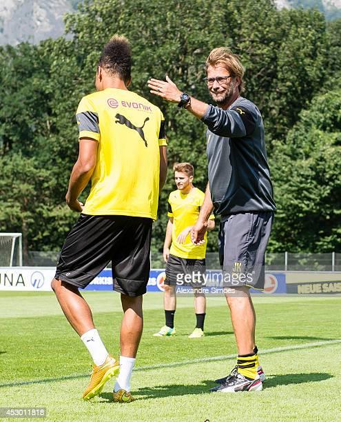 PierreEmerick Aubameyang and Head coach Juergen Klopp of Borussia Dortmund during a training session in the Borussia Dortmund training camp on July...