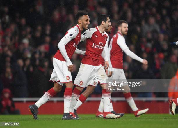 PierreEmerick Aubameyang and henrikh Mkhitaryan of Arsenal celebrate the 1st Arsenal goal during the match the Premier League match between Arsenal...