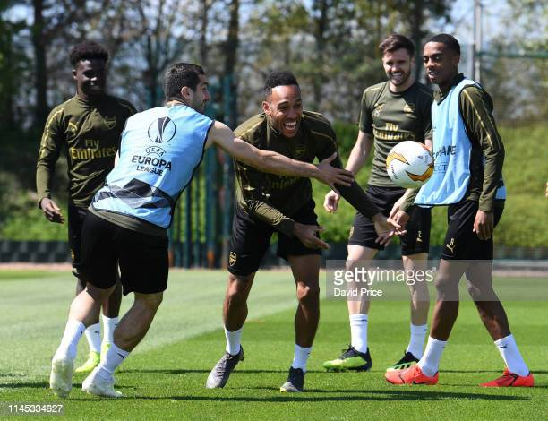 PierreEmerick Aubameyang and Henrikh Mkhitaryan of Arsenal during the Arsenal Training session at London Colney on May 21 2019 in St Albans England
