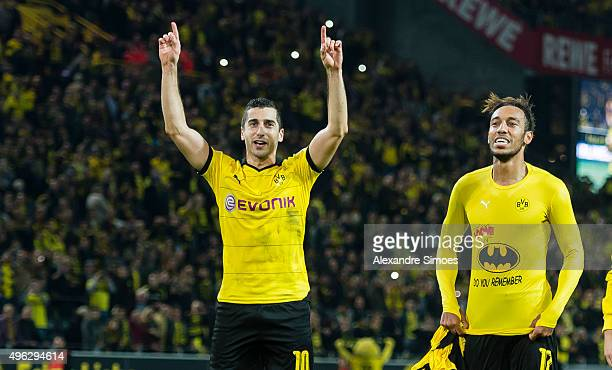 PierreEmerick Aubameyang and Henrikh Mkhitaryan of Borussia Dortmund celebrates the win after the final whistle during the Bundesliga match between...